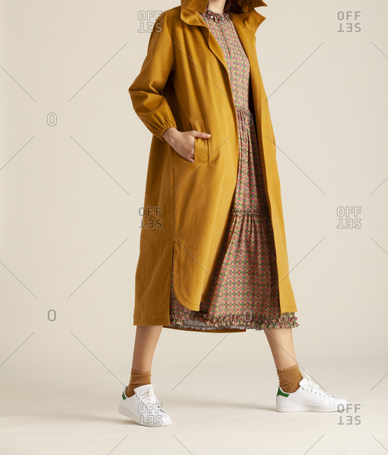 Studio shot of a model with yellow coat