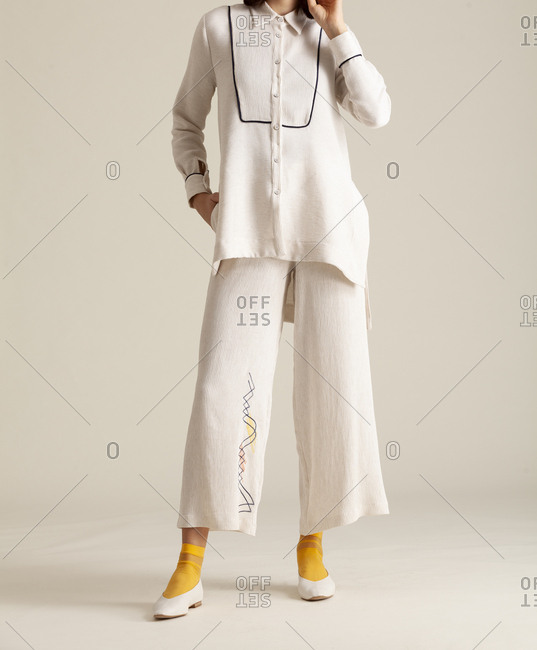 Studio shot of a model with white outfit