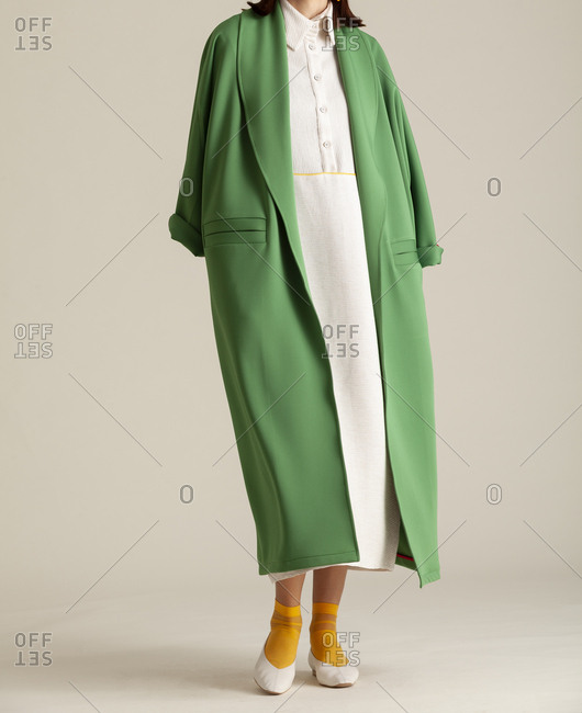 Studio shot of a model with green coat