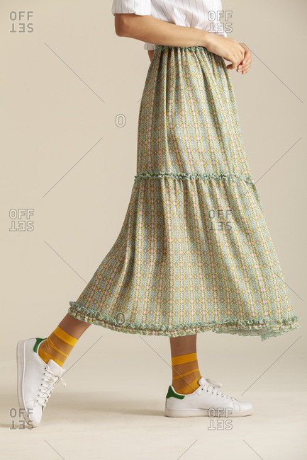 Studio shot of a model wearing a long skirt