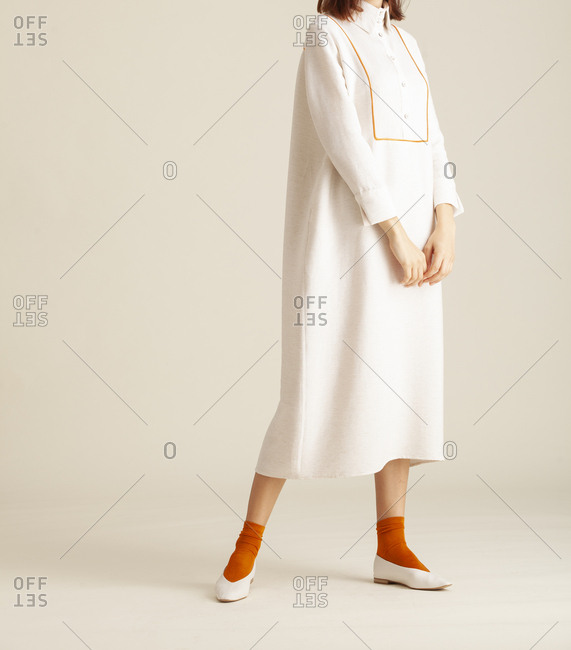 Studio shot of a model wearing a long dress