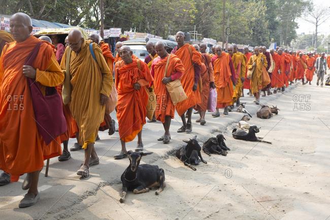 Bodh Gaya, India - February 27, 2015: Monks at the Mahabodhi temple