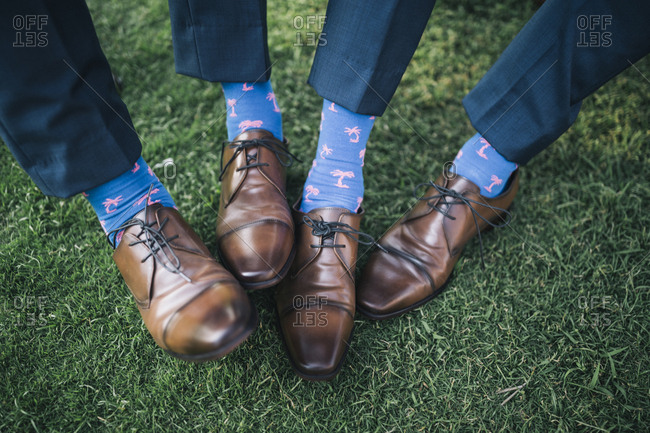 Hoi An, Vietnam - April 28, 2018: Close up of matching suits, socks, and shoes on groomsmen