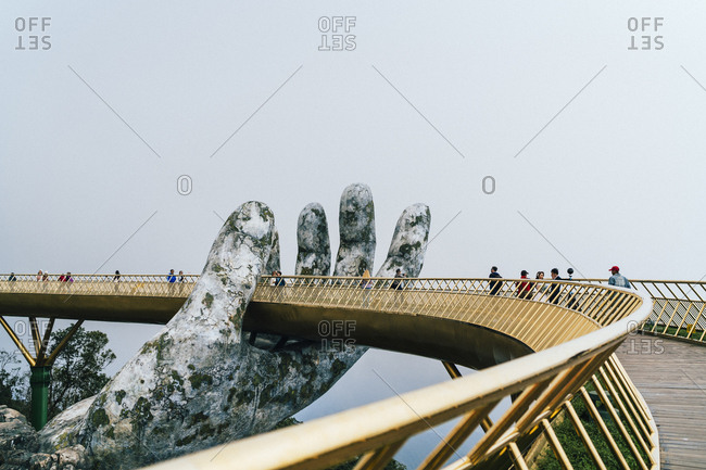 Danang, Vietnam - October 30, 2018: People walking on the Golden Bridge in Ba Na Hills, central Vietnam