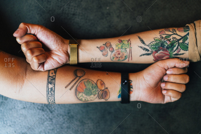 Ho Chi Minh City, Vietnam - November 01, 2018: Two girlfriends with matching Vietnamese food tattoos