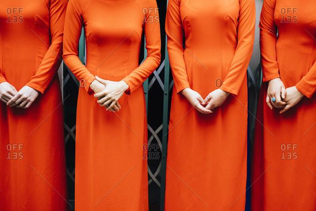 Hanoi, Vietnam - October 27, 2018: Bridesmaids dressed in orange
