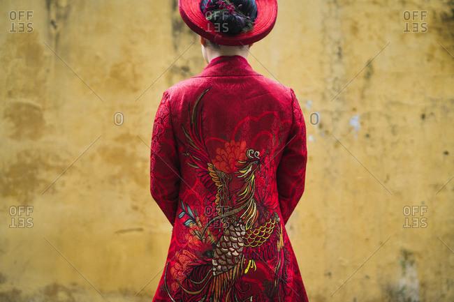 Hanoi, Vietnam - October 27, 2018: A bride wearing a traditional red ao dai (a Vietnamese wedding dress) on her wedding day