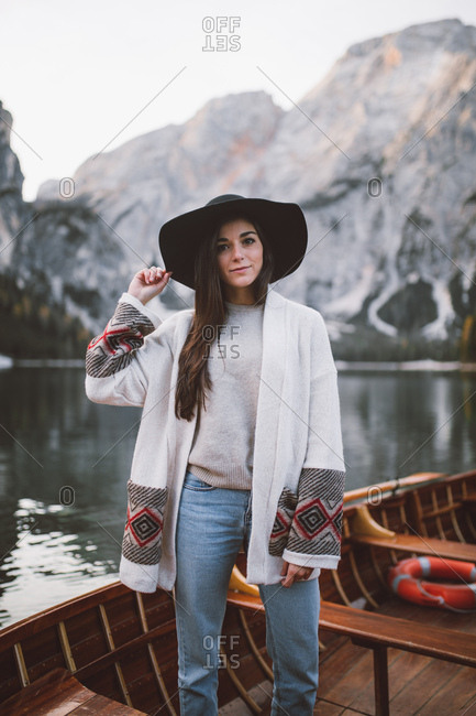 Woman with hat on, on a wooden boat, Lago di braies
