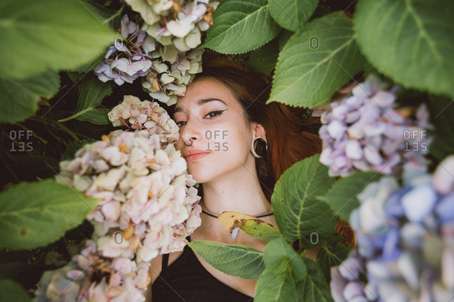 Portrait of a pretty young woman between flowers