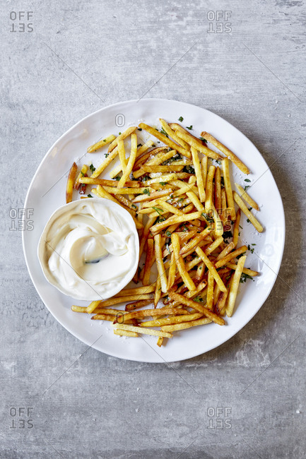 Fries with mayonnaise on a large plate