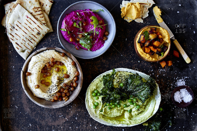 Variety of hummus with toasted pita bread