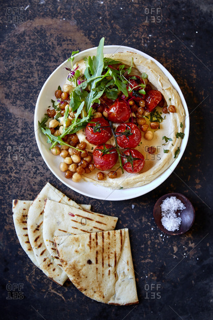 Hummus with roasted vine tomatoes and pita bread