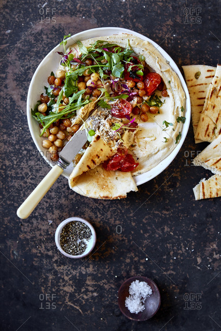 Hummus dip with pita bread and knife