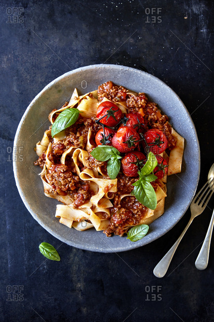 Pappardelle with ragu, vine roasted tomatoes and basil