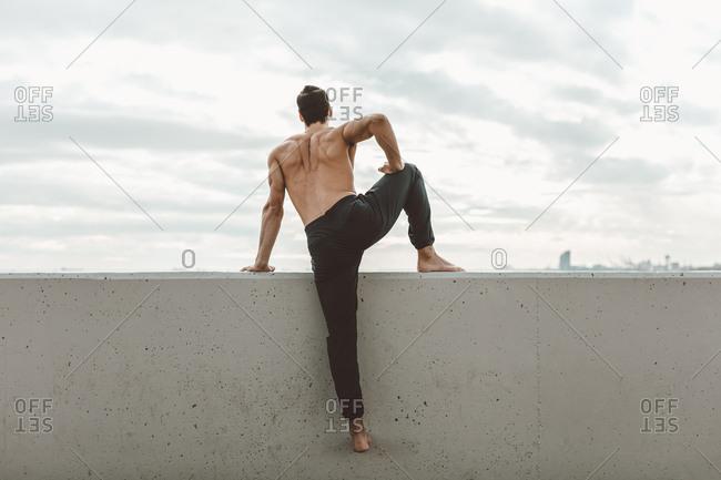 Men doing stretching leg pose