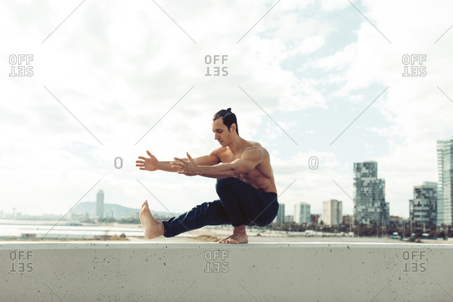 Men doing stretching leg pose