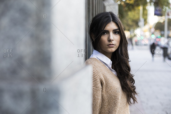 Beautiful young woman looking at camera in a street in Madrid, Spain