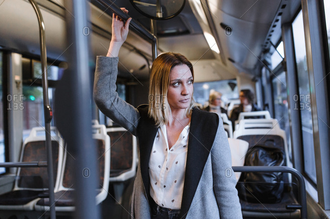Front view of business woman traveling on a bus