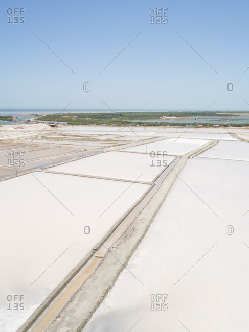 Aerial view of white salines industry near the ocean, Brazil.