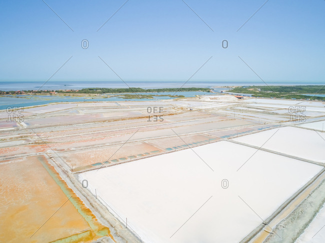 Aerial view of big salt industry near a coastal village, Brazil.