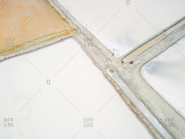 Aerial view above of white salines industry near the ocean, Brazil.