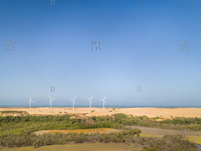 Aerial view of wind turbines on the top of dunes, Brazil.