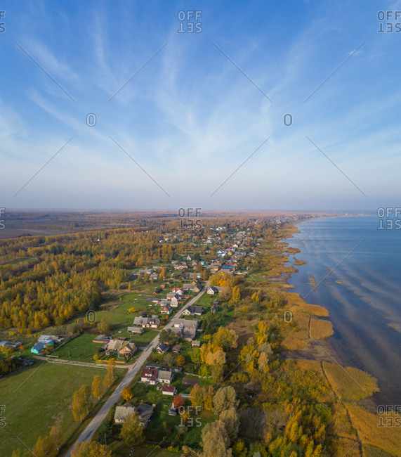 Aerial view of coastal town near calm water during the autumn, Estonia.