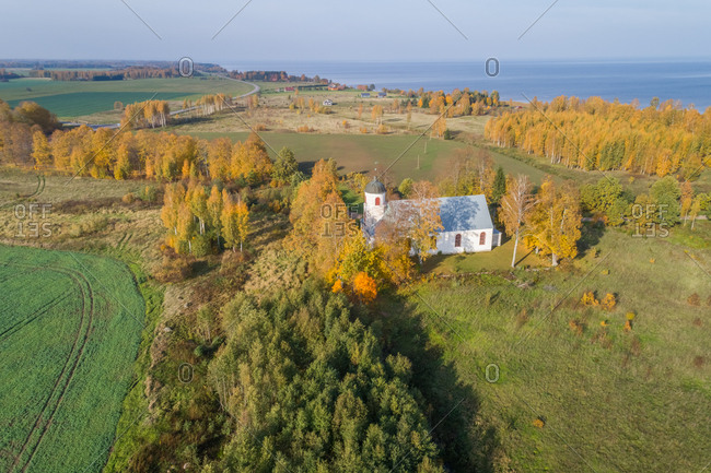 Aerial view of an isolated church in the middle of a forest, Estonia.