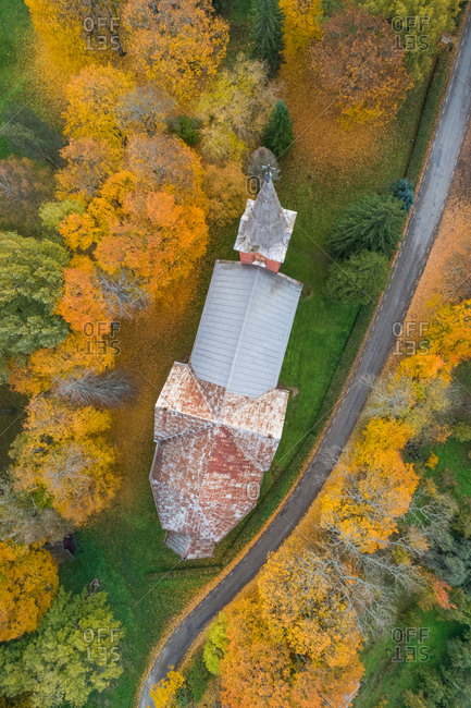 Aerial view above of an old church in the middle of a forest, Estonia.