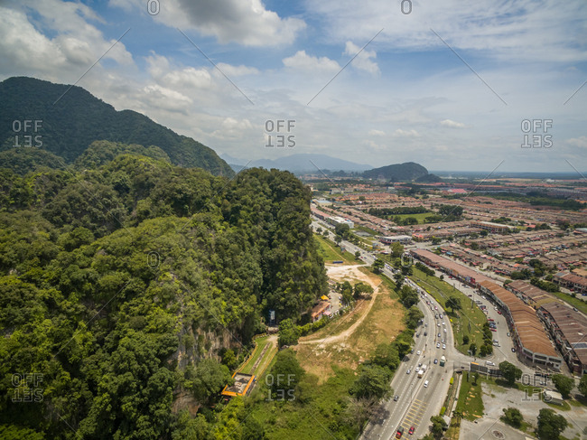 Aerial view of Ipho cityscape surrounding by mountain, Perak, Malaysia.
