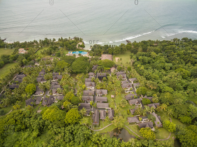 Aerial view above of traditional bungalow resort, Java island, Indonesia.