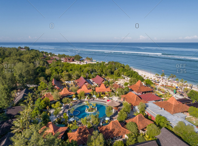 Aerial view of vacation resort with round pool near the beach, Indonesia.