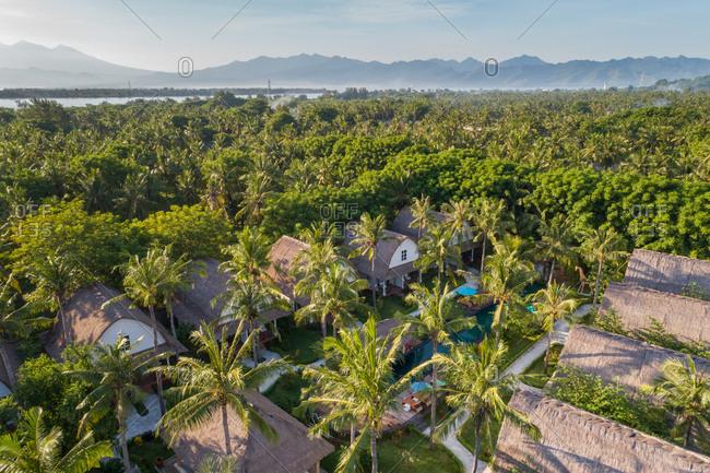 Aerial view of bungalows in a luxury resort, Gili Trawangan island, Indonesia.