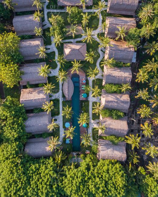 Aerial view of swimming pool between bungalow, Gili Trawangan island, Indonesia.
