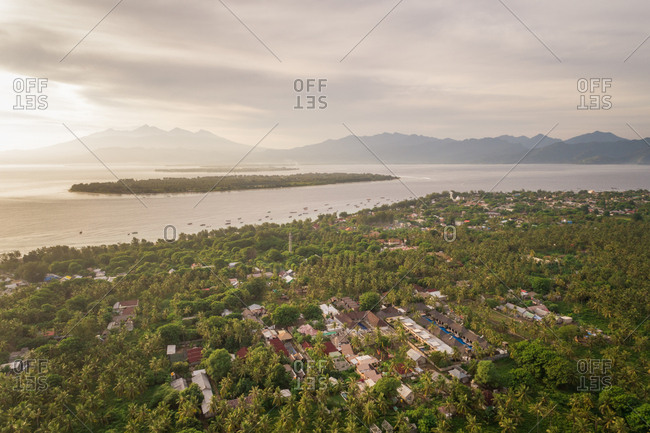 Aerial view of Pemenang city surrounding by tropical forest, Lombok island, Indonesia.
