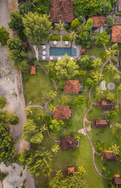 Aerial view above of swimming pool in luxury resort, Gili Trawangan, Indonesia.
