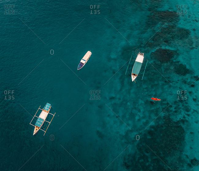 Aerial view at group of traditional boats anchored next Gili Trawangan island, Indonesia.