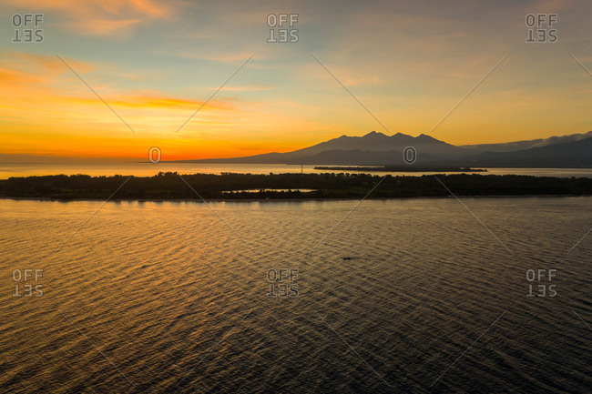 Aerial view of amazing sunset behind a mountain, Gili Trawangan, Indonesia.