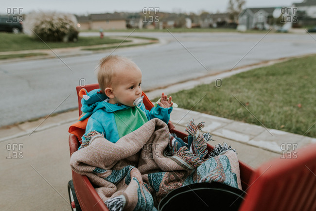 Baby riding in wagon on Halloween