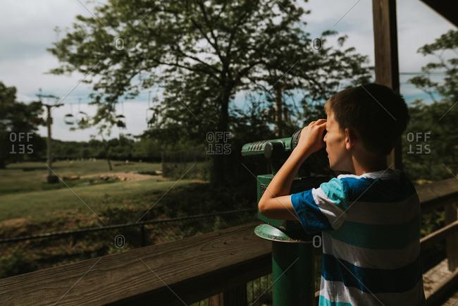 Boy looking through viewfinder
