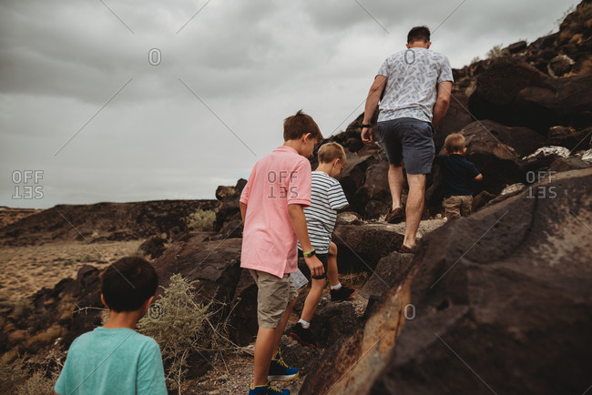 Father and boys hiking up mountains