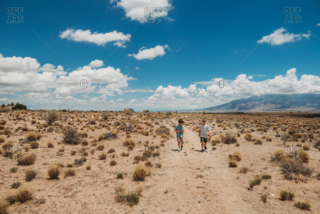 Two boys walking in the desert