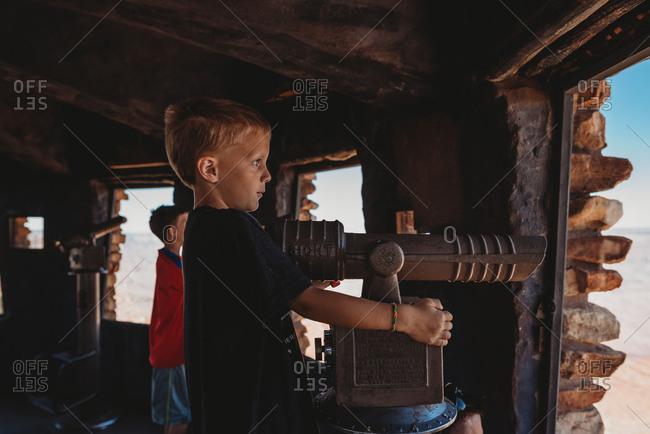 Boy using a viewfinder at Grand Canyon National Park