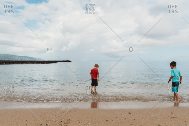 Two boys playing in the ocean