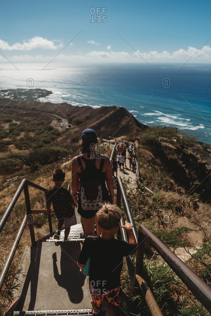Elevated view of family walking down steps on the coast of Hawaii