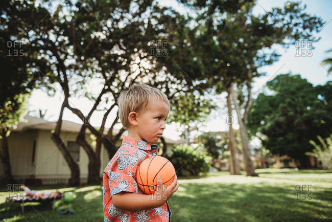 Toddler boy holding small basketball