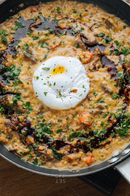 Overhead view of dish in a pan with poached egg