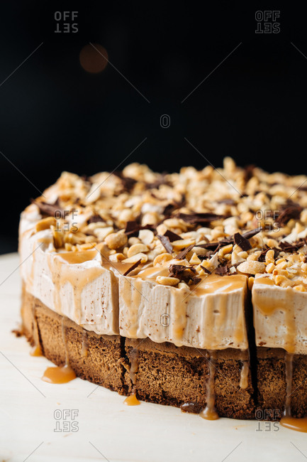 Cheesecake with nuts, chocolate, and caramel