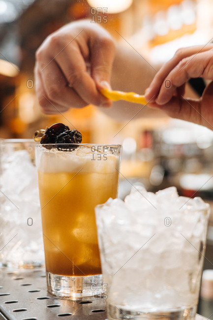 Bartender preparing a variety of drinks