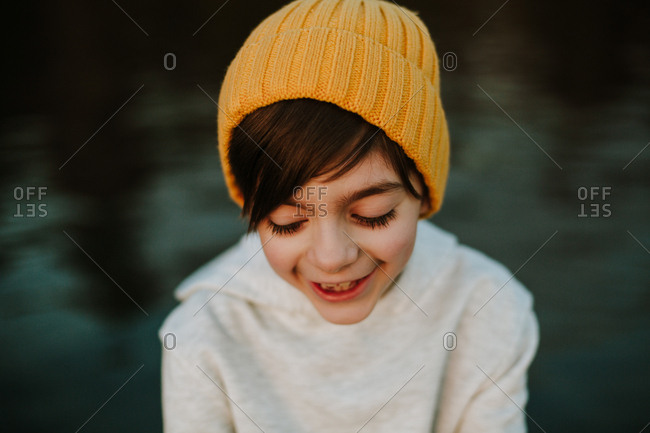 Portrait of a happy young boy wearing a yellow hat